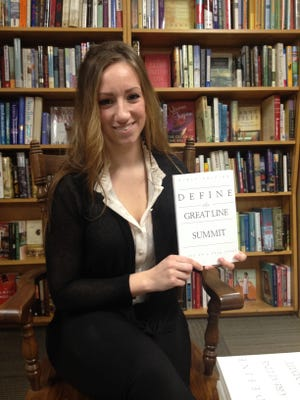 "Courtney Young with her first book, ""Summit."""