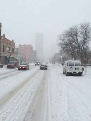 Heavy snow was falling in downtown Battle Creek at 3:45 p.m. Tuesday
