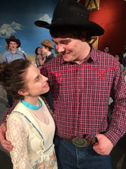 """Courtney Miller (left) and Austin Miller romance during the Regis High School staging of """"Oklahoma!"""""""