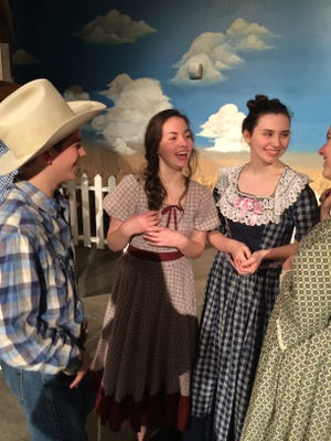 "(From left) Derek Boyd, Natalie Caudel and Elish Gomely in ""Oklahoma!,"" opening on Thursday at Regis High School"