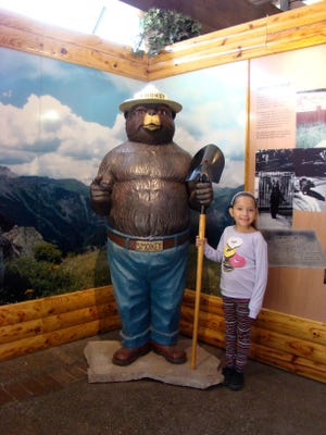 Six-year old, Aaliyah visited Capitan's Smokey Bear Historical Park and stopped to pay her respects at the gravesite of Smokey Bear, America's most famous bear. Smokey lives on in the hearts of children.