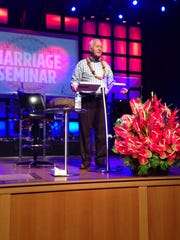 Gary Smalley is shown onstage at a marriage seminar.