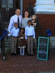Richard and Brittany Oden stand with their children, left to right, Kentrell, Gabbi, Elijah and Annabelle.