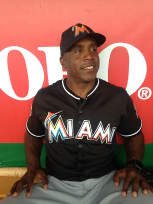 Barry Bonds meets with the media in the Hammond Stadium dugout. Bonds, the all-time home run leader in baseball, is the new hitting coach of the Miami Marlins.