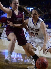 Community senior Jordan Huntley (right) dribbles along the baseline around South Greene's Kinsley Wykle during Friday's Class A semifinal.