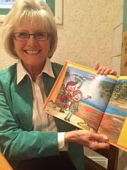 Ilona Holland, of Rehoboth Beach, with her new children's book, Buddy Bison's Yellowstone Adventure.