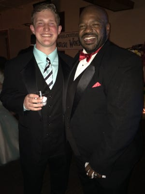 Will Rasmussen, right, a senior at Leon High, poses for a photo with teacher Rod Durham at prom last year.