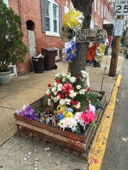 Less than a block down North Franklin Street, a memorial commemorates another victim of the city's gunfire. Police have not released further details in this particular shooting.