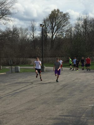 The Miami Valley Christian Academy football team works out at Short Park in Newtown.