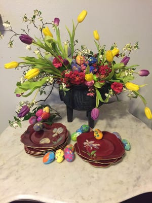 Clinton Whitney Downing's Easter centerpiece features eggs decorated by ARCO clients in the Drawn Together Arts Program, along with the vibrant colors of spring in tulips, dwarf azaleas and miniature dogwood branches gathered in Monroe's Garden District.