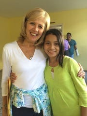 Volunteer Beth Murphy bonds with the young people in Honduras, including Sara, from Pedro Atala.