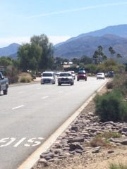 Traffic flows along Gene Autry Trail in Palm Springs.