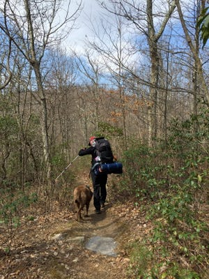 David Paulk and his dog, Abe, hike Riprap Trail at Shenandoah National Park on Saturday, March 26, 2016.