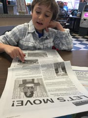 Jack reading the newspaper.