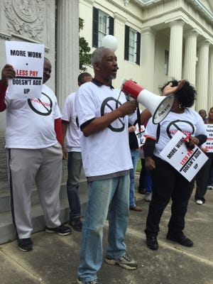 Retired city employee John McGee speaks Friday during a protest outside City Hall against Jackson's monthly furloughs. The policy, created as a cost-saving measure, could save the city a million dollars this fiscal year, city spokeswoman Shelia Byrd said.