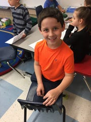 First grader Benjamin Garber poses for a photo. His family moved to Virginia from North Carolina in January.
