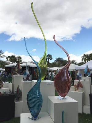 Artwork is displayed during the closing day of the 2016 La Quinta Arts Festival.