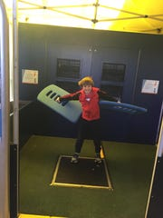 Jack in a wind tunnel becoming a human plane at The Franklin Institute.