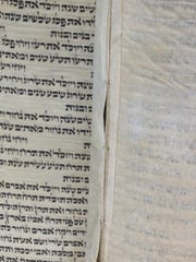 Pages of the torah are sewn together.