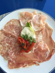 The antipasto misto plate, with burrata cheese, prosciutto,