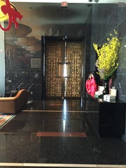 The entrance to the swank Mandarin Bar off the 23rd