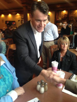 Rep. Todd Young, one of two Republicans running to succeed retiring Sen. Dan Coats, greeted voters at Concannon's Bakery Cafe on April 7, 2016.