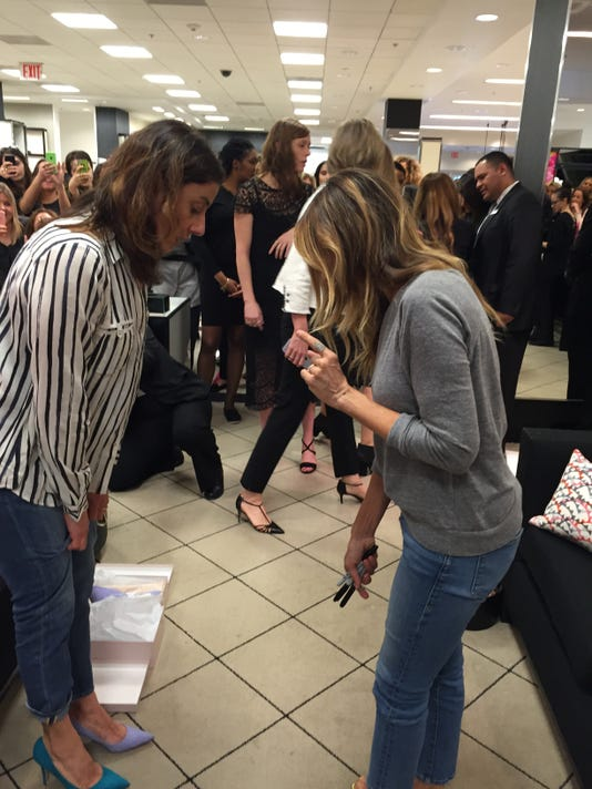 Sarah Jessica Parker helps customer buy shoes