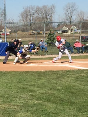 Bellevue's Jared Auten swings at a pitch Saturday at Clyde. Bryce Ray scored the go-ahead run in the eighth on a single from Auten.