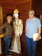Sara Fuhrer and Paul Smith stand next to a nearly  life-size cut-out of Elvis Presley in her home near Lecompte.