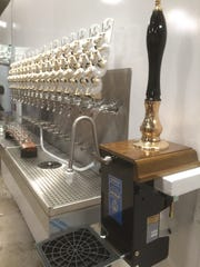 A cask conditioned ale tap is part of the mix at the 3 Sheeps Brewing taproom in Sheboygan.