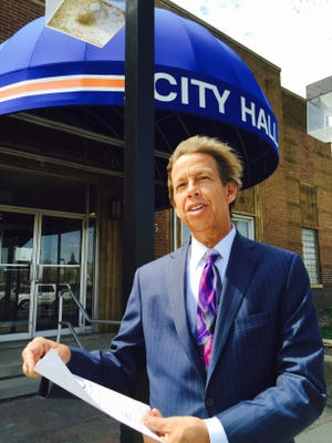 Lincoln Park City Attorney Ed Zelenak, seen standing in front of City Hall last year, said he's is an advocate of holding virtual meetings via the internet during the COVID-19 pandemic on Oct. 15, 2020, shortly after the Legislature passed a bill allowing them.