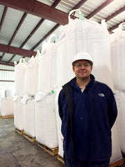 Greg Thayer, president and CEO of Montana Milling Inc., stands in the company's Great Falls production plant in front of 2,000-pound super sacks of grain. He said the company plans to add a bulk flour option later this year for customers who want to buy even larger quantities by rail or truck.