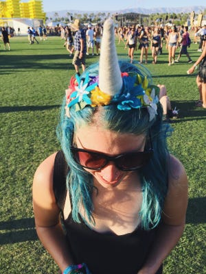 Attendee representing all things colorful with her blue hair and unicorn headband at Coachella 2016 weekend one.