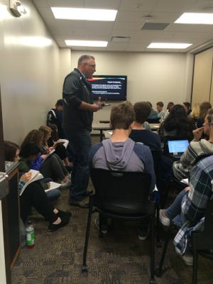 David Meixl, an AP Psychology teacher from Appleton North High School, runs a 30-minute lesson at the Fox Valley AP Psychology Review Session last week. So many students attended that they overflowed from the rooms.
