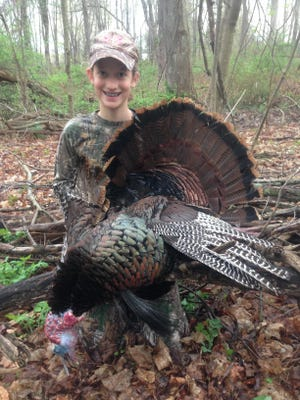 In this 2016 file photo, Fishkill's Emma Sandison, 12, poses with a 22.25-pound gobbler during the youth turkey hunt.