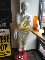 "This piece at Wedge Cheese Shop entitled ""Rind and Reason"" represents the cheese making process. The statue is from the 2015 Artown People Project."