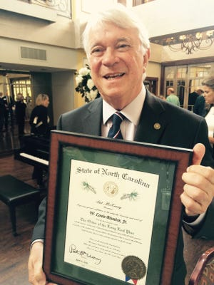 Former Asheville Mayor Lou Bissette received the state's highest honor Wednesday, the Order of the Long Leaf Pine.