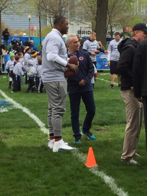 Mississippi State defensive tackle Chris Jones talks with Chicago mayor Rahm Emanuel at the NFL's Play 60 clinic Wednesday. Jones is set to be an early NFL Draft pick.