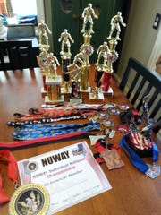 This is a collection of the trophies and ribbons Maddie Rhees has won for her wrestling exploits.
