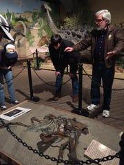 Museum director Otis Kline and bible college students