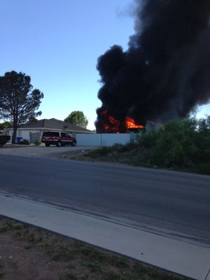A car port with two RV's caught fire Monday afternoon in Carlsbad.