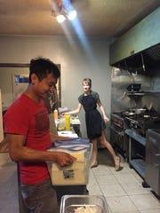 Khai Nguyen, co-founder of Veggi Farmers Coop, delivers