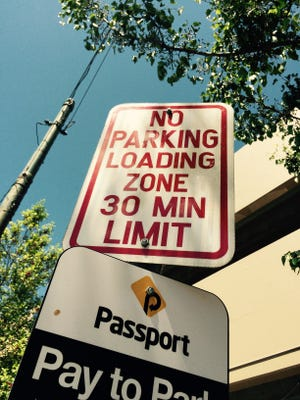 Any registered vehicle can park in a loading zone as long as it is legitimately loading or unloading.