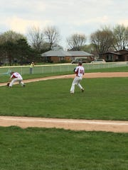 Port Clinton's Seth Monk fields a ground ball at third after twin brother Trevor threw a pitch.