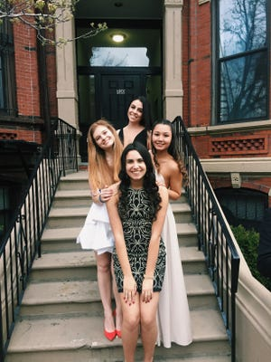 DeStefano and her family within the sorority wore shades of black, white and gold to their formal at the New England Aquarium.