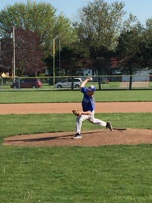 Clyde's Matt Baker throws a pitch Friday at Port Clinton.