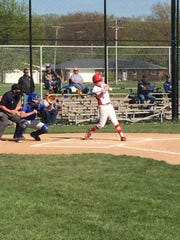 Port Clinton's Noah Smith fouls off a pitch Friday in the first inning.