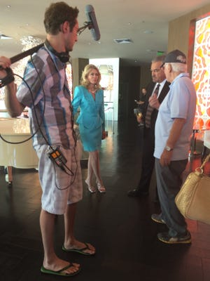 """The director of """"Do It Or Die"""" Jorn Winther on far right, talks to the lead actors Denise DuBarry and John Callahan."""
