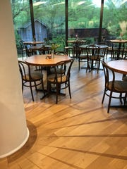 "The Millstone Cafe at the Brandywine River Museum of Art, which features a curved wall overlooking the banks of the Brandywine, has been redecorated, with wood plank flooring designed by founder George ""Frolic"" Weymouth, who helped tape and retape the stain pattern until he felt like it accurately reflected the millstone-like ceiling and the BRMA's logo, down to the shadow on the floor at the base of the central column."