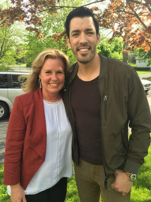 """Keller Williams Realtor Lynn Garcia poses with Drew Scott of """"Property Brothers."""" Scott was in Blauvelt Monday scouting a house for the brothers' """"Buying and Selling"""" show on HGTV."""